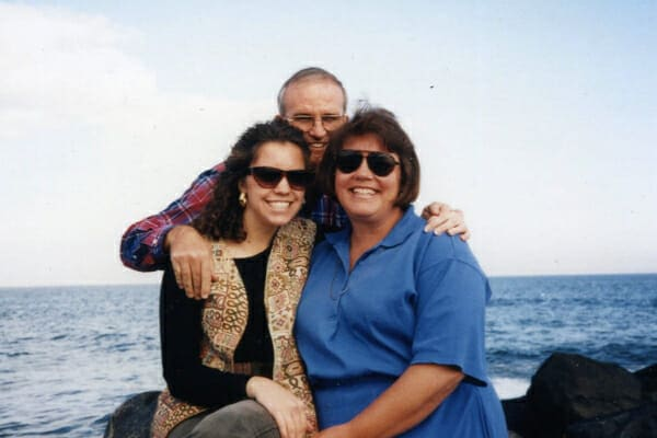 Dr. Buzby with her mother and father in front of the ocean, photo