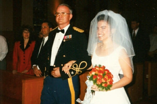 Dr. Julie Buzby with her dad walking down the aisle on her wedding day, photo