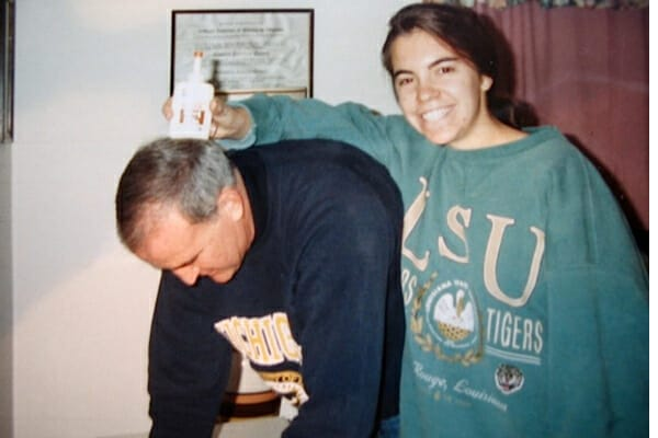 Dr. Julie Buzby as a teenager working on a project with her dad, photo