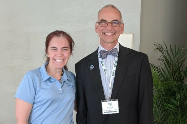 Veterinarian Julie Buzby and Dr. Harvey smiling for discussion about managing pain in dogs