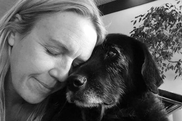 dog mom comforting elderly dog. photo.